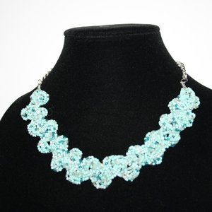 Beaded necklace with pastel blue beads
